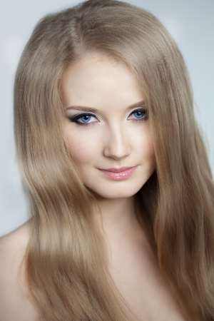 Beautiful woman with a volumetric hair Stock Photo - 14723223