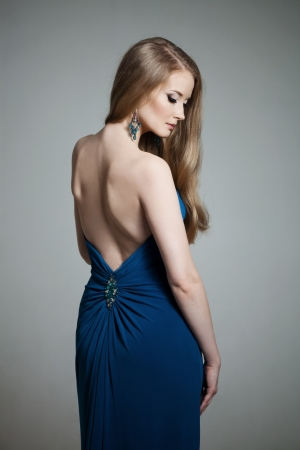 Luxury woman in a dress with a bareback dress photo