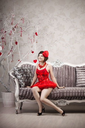 Girl in red on a luxury background Stock Photo