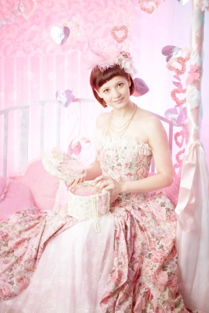 Romantic woman in a pink vintage dress photo