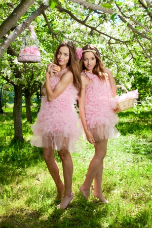 Twin girls in pink doll style photo