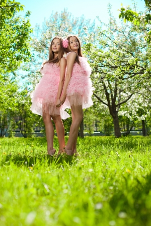 Twin girls in pink doll style Banco de Imagens