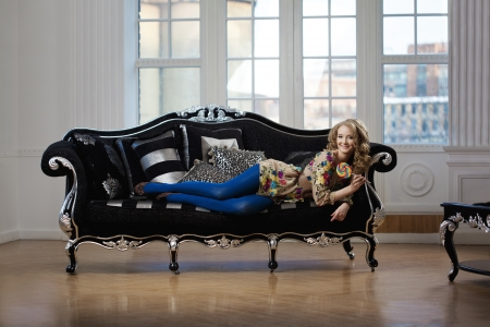 Beautiful woman in luxurious sofa photo