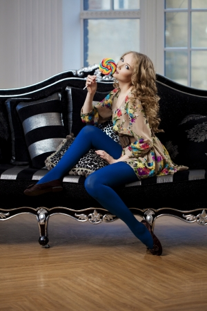 luxurious sofa: Beautiful woman in luxurious sofa