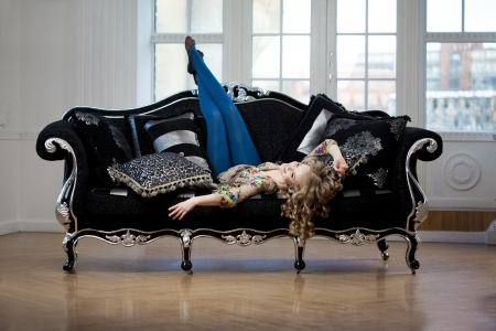 Beauty woman in luxurious sofa photo