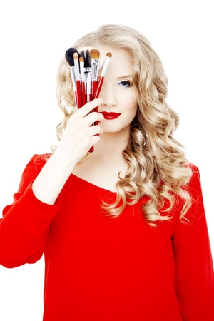 esthetician: Professional stylist with make-up brushes