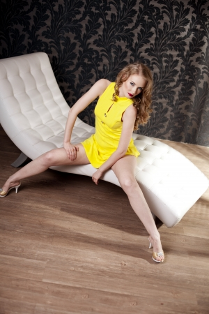 A beautiful, luxury woman in a short yellow dress photo
