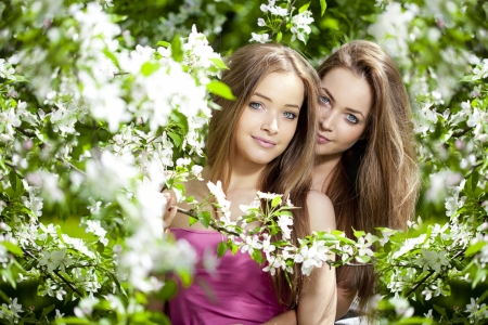 Beautiful twins with flowers photo