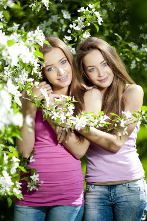 Beautiful twins with flowers