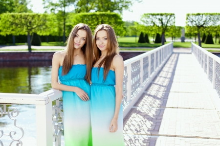 Beautiful twins in the park