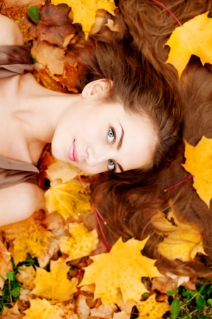 Woman in the autumn park photo