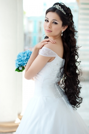 bridal makeup: Beautiful happy girl with long hair outdoor