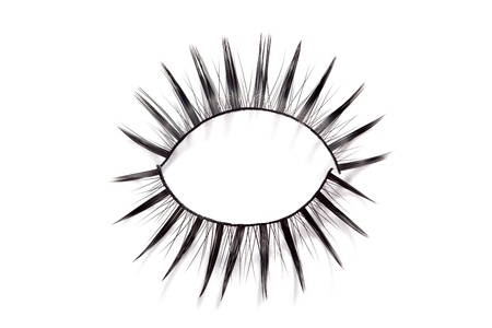 False eyelashes on white background photo