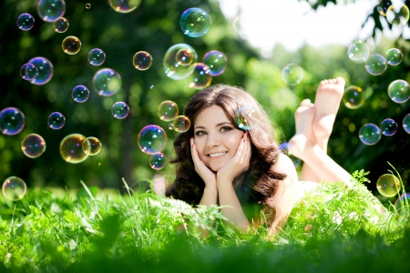 Woman and soap bubbles in park  photo