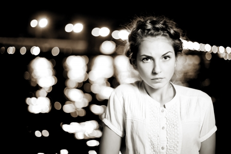 Beautiful woman on the background of night city ligthts photo