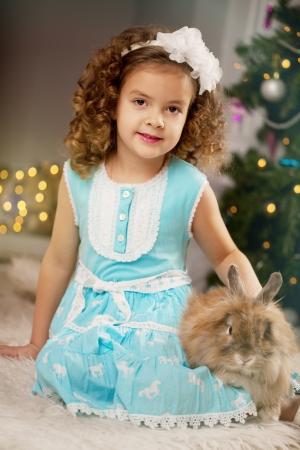 hristmas: Little smiling сhristmas girl with bunny