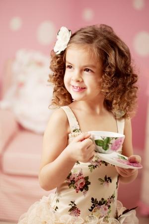 birthday tea: Little cute and sweet girl with tea Stock Photo