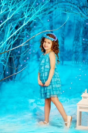 child alone: Little and cute winter fairy tale girl Stock Photo