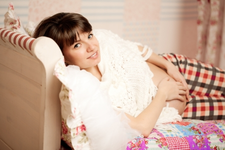 Beautiful cute pregnant woman indoors photo