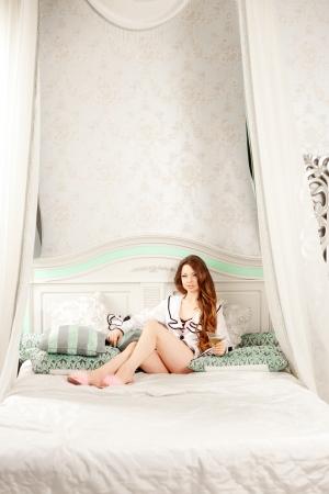 Fashion rich woman in luxury interior photo