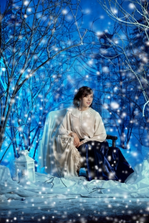 Beauty young woman in winter forest photo