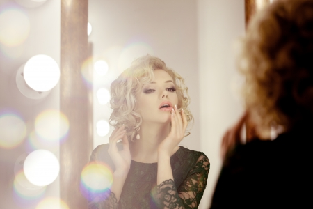 Beauty luxury woman with  and mirror photo