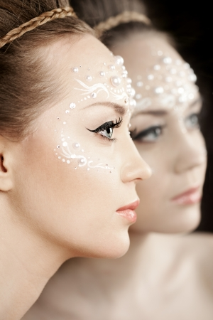 Stylish woman with creative make-up of pearls photo