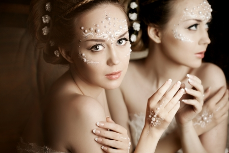 magic eye: Stylish woman with creative make-up of pearls Stock Photo