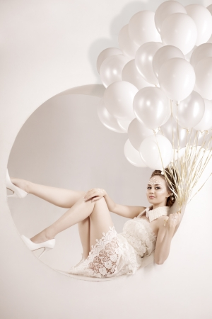Stylish woman with balloons in hands photo