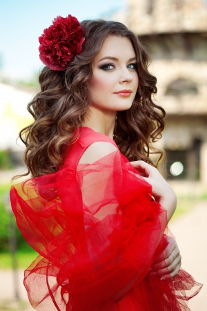 girl in red dress: Beautiful woman in a bright red dress of the mill Stock Photo