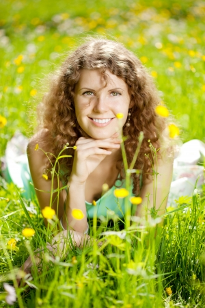 Happiness young beauty woman in field of flowers photo