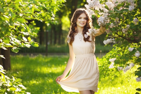 Young Woman and flowers Stock Photo