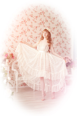 A beautiful young woman in vintage lace dress photo