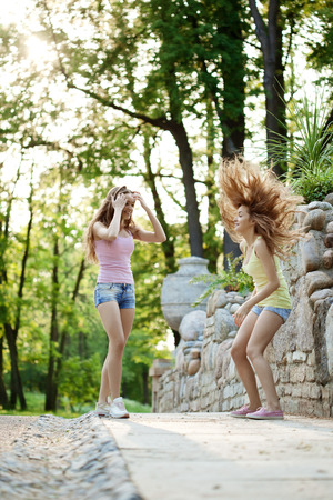 Beautiful young happy twins outdoors  photo