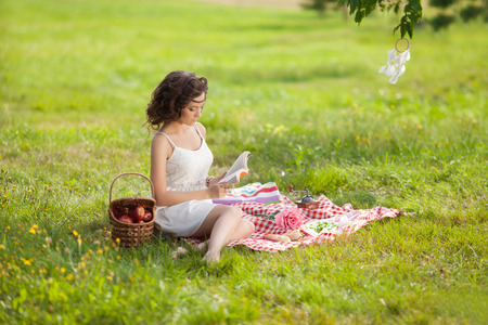 picknick: Beautiful girl on picnic on nature. Beautiful Young girl Outdoors. Enjoy Healthy Smiling Girl.  Stock Photo