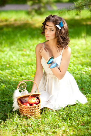 Beautiful woman on picnic on nature. Beautiful Young girl Outdoors. Enjoy Healthy Smiling Girl.