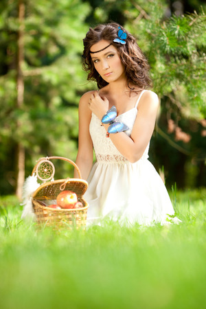 picknick: Beautiful woman on picnic on nature. Beautiful Young girl Outdoors. Enjoy Healthy Smiling Girl.