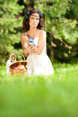 Beautiful girl on picnic on nature. Beautiful Young girl Outdoors. Enjoy Healthy Smiling Girl.  photo
