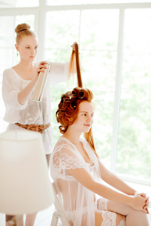 hair dresser: Hair stylist makes the bride before the wedding Stock Photo