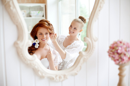 Hair stylist makes the bride on the wedding day  photo