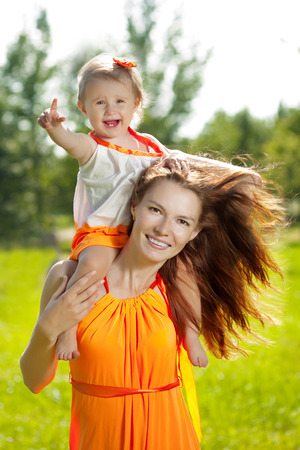 Beautiful Mom and baby outdoors. Happy family playing in nature. Mom and baby. Mother and child.  photo