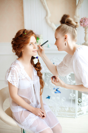 up service: Stylist makes makeup bride on the wedding day