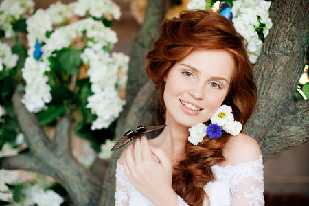 Beautiful bride in a luxurious interior with flowers photo