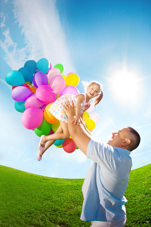Father Throws Daughter. Familly Playing Together In Park With ...