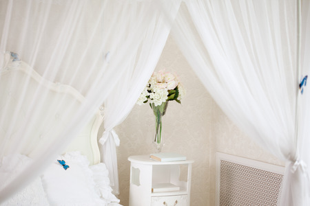 canopy: The bedroom in light pastel colors  Stock Photo