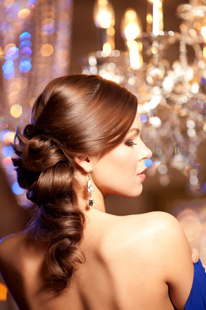 Luxury fashion stylish woman in the rich interior. Beauty girl with a fashionable  hairstyle and makeup chic photo