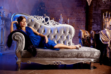 luxurious background: Luxury fashion stylish woman in the rich interior  Beautiful girl with a fashionable hairstyle and makeup chic