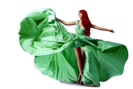 Luxury beautiful young woman in a long evening dress. Beauty girl in flying long silk dress photo