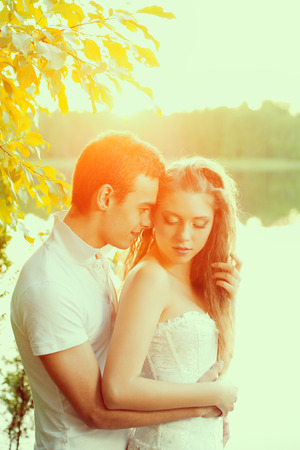 man woman hugging: Loving couple hugging on the lake. Beautiful young woman and man in the of the sun shining. Happy smiling Loves a date