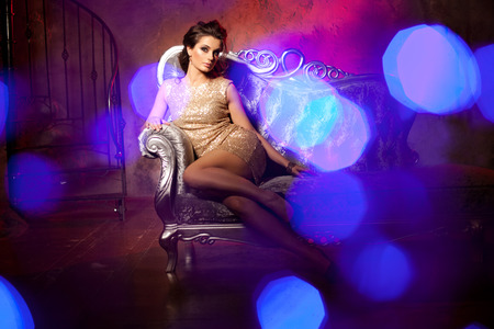 diamond candle: Luxury young woman in expensive interior. Young girl with flawless makeup and evening volume hairstyle.